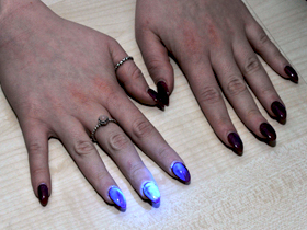 Hands under UV light