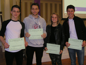 Students receiving their second place certificates.
