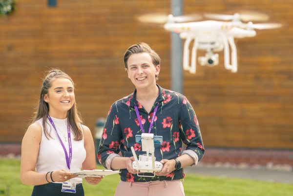 Creative Digital Media Production students flying a drone at the College