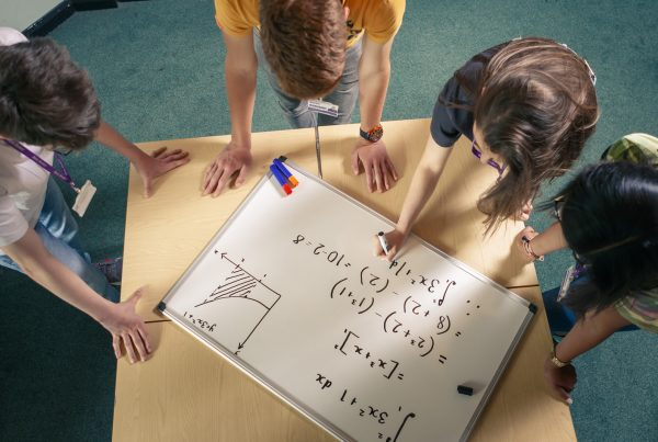 Core Maths students working on a whiteboard